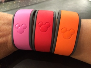 My MagicBands - Pink from Port Orleans, Red from Boardwalk, and Orange from POP Century