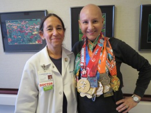 with my medical oncologist celebrating all the races during treatment