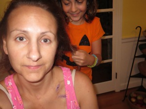 Look at my face and then look how happy my daughter is to cut off my hair.