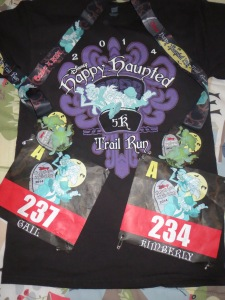 Glow in the dark t-shirts and medallions with the race bibs.