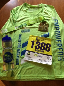 Finisher shirt, medal, water bottle and my bib